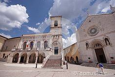 Square of San Benedetto and view over the old St. Benedict church and the city hall building in Norcia medieval town, Italy, province of Perugia