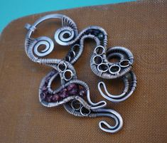 Making this little octopus was a real fun:) I used streling silver, georgous spinel and tourmaline.