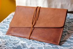 Tutorial for Simple Leather Envelope Bag -- or a pencil case or anything -- I didn't use this tutorial to make mine, but I stumbled upon it today. I don't wet my leather but I might give that a try next time to see how that work out.