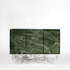 What this man does with stone. the 'Inverted Gravity sideboard' conceived by for this year's AD Intérieurs Paris. Bubbles of glass supporting a block of forrest green stone. Design Furniture, Sofa Furniture, Modern Furniture, Mathieu Lehanneur, Tea Trolley, Multipurpose Furniture, Design Blog, Tv Cabinets, Green Stone