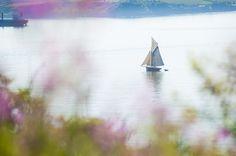 A sailing boat floating along the beautiful Falmouth coastline - We love Cornwall!