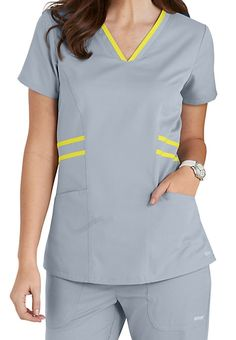 Striping detail at the waist and collar bring an upscale touch to this Grey's Anatomy Marquis top. Scrubs Outfit, Scrubs Uniform, Landau Scrubs, Salon Wear, Medical Uniforms, Hospital Uniforms, Greys Anatomy Scrubs, Uniform Design, Medical Scrubs