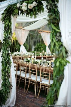 Gorgeous greenery defines entrance to this clear-top tent