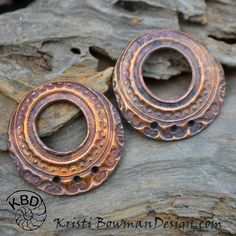 """Beautiful Tapestry design on these Off Center Rounds. Copper has been heated to bring out the natural color in the copper and sealed to protect. These components measure just over 1"""" in Diameter with 3 jump ring holes on the bottom. No Jump ring hole on top, just the large off center hole of just under .5""""."""