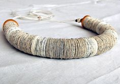 """Paper crafts! What a great idea if you have an old book! I would have problem cutting up any book though :P """"Two different books were used to create strips for this adorable book page necklace"""""""