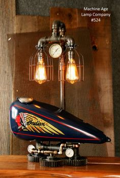 Steampunk lamp by Machine Age Lamps, Antique Early American Motorcycle Theme, from Re-purposed Motorcycle parts Industrial Style Lamps, Vintage Industrial Decor, Industrial Pipe, Steampunk Furniture, Steampunk Lamp, Garage Interior, Garage Art, Lampe Tube, Tailgate Bench