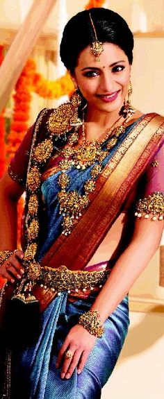 South Indian bride. Temple jewelry. Jhumkis.Blue silk kanchipuram sari.Braid with fresh jasmine flowers. Tamil bride. Telugu bride. Kannada bride. Hindu bride. Malayalee bride.Kerala bride.South Indian wedding.Trisha Krishnan.