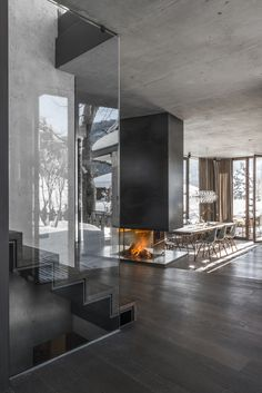 Designed by Gogl Architekten, the striking open fireplace was built by Mandl & Bauer stove fitters.