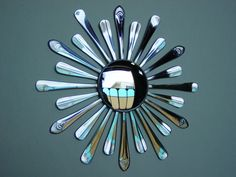 this guy uses forks, knives, and spoons to make these little mirrors! I could totally make this and add to my mirror collection for the dining room :)