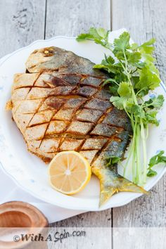 Don't be intimidated to cook whole fish. Learn the tips and tricks with an easy recipe of Whole Pomfret Fish. Feel free to substitute a sea bass, red snapper, flounder, or a small grouper for this Bengali style fish recipe. Fish Dishes, Seafood Dishes, Seafood Recipes, Indian Food Recipes, Cooking Recipes, Healthy Recipes, Cooking Corn, Cooking Fish, Cooking Salmon