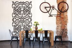 A historic reclaimed home offsets it's style with a faux iron grille on the wall.