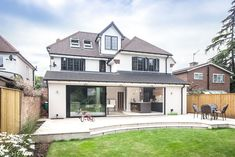 External shot of fully refurbished 1920s property in Weybridge by Lofts and Extensions (L&E). Don't move, extend!