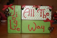 2x4s, scrapbook paper, letters and mode podge.  You know I wanna do this!