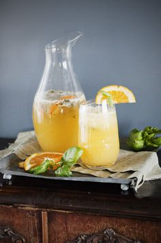 Orange Basil Mojito Recipe 1 cup freshly squeezed orange juice 1/2 cup thick simple syrup (see instructions) 10 large fresh basil leaves, stems removed and discarded 1 cup white rum 1 cup club soda Crushed ice Orange slices, for garnish Additional basil leaves for garnish