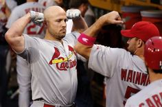 St. Louis Cardinals' Matt Holliday, left, and Adam Wainwright, right, clown around in the dugout before a baseball game against the Pittsbur...