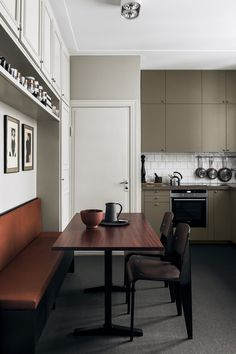 Olive green and warm cognac brown kitchen. Sophisticated and soothing.