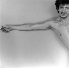"""Robert Mapplethorpe: young man with extended arm, 1975. - """"... la main dans son bon degré d'ouverture, sa densité d'abandon..."""" - (p. 94)"""
