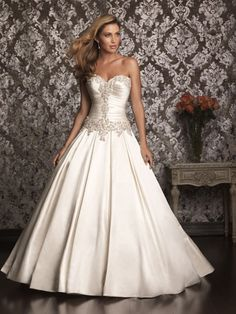 Extraordinary satin ball gown with a ruched drop waist bodice ...