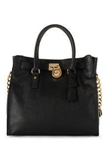 From new and exciting styles to timeless and iconic pieces, explore our collection of bags including backpacks, cross body bags and luggage at Selfridges. Michael Kors Tote, Handbags Michael Kors, Michael Kors Hamilton, Tote Handbags, Mk Purse, Oversized Sunglasses, New Bag, Tom Ford, Crossbody Bag