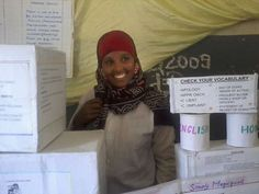 Becoming a refugee opens up the world of education to young Somali woman : Somali #refugee Hali Shukri Ibrahim smiles from behind stacks of study aids at Massawa High School near Umkulu Refugee Camp in the port town of Massawa, #Eritrea. The 26-year-old paradoxically found that becoming a refugee gave her what she always had longed for – an #education.