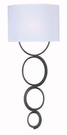 One Light Wallchiere - Stacked circles with a serpentine effect give Circo its contemporary twist. Clean and a little mod, this wall decor can hang in a retro fashion, but stays young at heart. * Can be Hard Wired or Cord/Plug Mounted* 6 Foot Cord/Plug Included