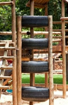 Kids jungle gym, made out of wood and tires Stock Photo - 12332609
