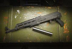 SEG AK-47 w/ underfold stock and Stainless Steel SEG Hancock Suppressor. Available at https://www.segsuppressors.com/suppressors.html