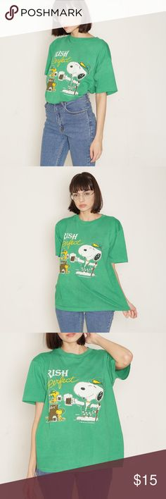 """'70s vintage // Irish snoopy green tee shirt DETAILS vintage '70s Snoopy """"Irish & Perfect"""" tee shirt. Shirt is super comfy & worn in.   CONDITION small spots that are more visible in pics than person & some pilling on fabric  MEASUREMENTS  no size marked  bust 45"""" waist 40"""" length 23.5"""" sleeve length 8.25""""                                                                            ALL PHOTOS ARE ORIGINAL &  OF THE ACTUAL ITEM BEING SOLD. No trades or holds. All items will ship within 1-2 days…"""