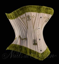 Coutil corset with moss green velvet binding, circa 1884