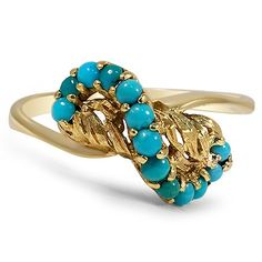 This distinctive ring from the Victorian era showcases a rolling wave of round turquoise cabochons in a tantalizing blue hue against a beautiful background of textured yellow gold for an utterly unique and irresistible piece.