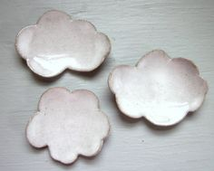 little cloud dishes. JD Wolfe Pottery on etsy. >> These would look SO cheery on a wall!