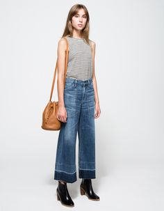 striped tank top, leather bucket bag, contrast wide-leg cropped jeans & ankle boots #style #fashion #culottes #denim