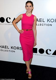 Pretty in pink: 32-year-old actress Alison showed off her slim waist and trim figure in a body-hugging sleeveless dress