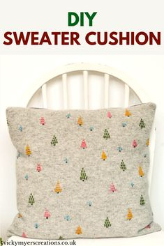 Update your home decor with this hygge embroidered cushion cover, the tutorial includes videos of how to embroider the trees. Transform your old sweater into a cushion cover #upcycledsweater #diycushioncover