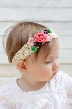 This free crochet flower headband pattern is surprisingly easy and it makes an adorable headpiece for a young flower girl in a wedding (or a bohemian beauty of any age)! Sizes include newborn, baby, toddler, child, teen and adult. | MakeAndDoCrew.com