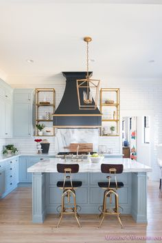The ultimate guide on styling open kitchen shelves...    kitchen-white-marble-calcutta-gold-open-shelves-gold-black-vent-hood-blue-gray-cabinets-shaker-style-black-chevron-tile-subway-white-backsplash-decor-ideas-3-of-32