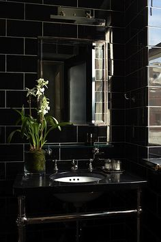 Chic black Ceramic Subway tile bathroom: Found at http://www.subwaytileoutlet.com/