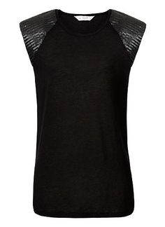 100% Linen Jersey Shoulder Sequin Tank. Comfortable yet neat fitting silhouette features a scoop neck, raglan padded shoulders complete with sequin applique. Available in Black as seen below.