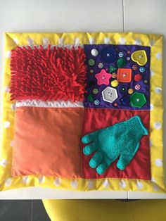 Sensory blanket quilt Glove has bells inside. Orange square has crinkly material inside. Diy Sensory Blankets, Fidget Blankets, Sensory Activities Toddlers, Baby Sensory, Diy Crafts For Gifts, Crafts To Sell, Baby Quiet Book, Diy Dog Toys, Learning