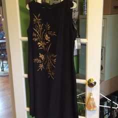 Gorgeous LBD sleeveless w oriental gold design Black silk sleeveless dress that has a beautiful gold oriental design on the side. Classy and chic silk dress. Small slits on the side . Never worn with tags this Kasper dress is a bargain! Kasper Dresses Midi