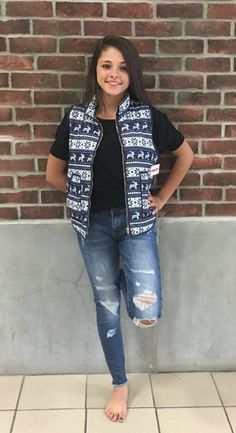Reindeer printed tops are the season's biggest craze! Accents of snowflakes and reindeer ensembles this quilted fair isle fabric. This padded vest has deep slip pockets and a high collar that will define your pretty-yet-practical layer.