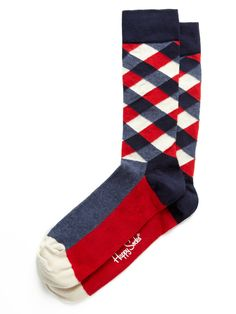 Socks are where you can go crazy. Most people won't notice and those who do will think you're rad. Totally a great way to show style in a business environment that is traditional/conservative.