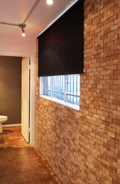 wall covered with ends of wood planks like bricks