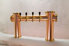 Brushed copper beer tower with brass details.