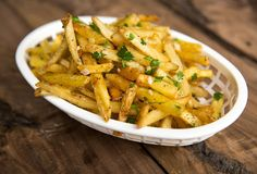 The Secret to Making the San Francisco Giants' Garlic Fries (uses vegetable oil, frozen french fries, olive oil, fresh garlic, fresh parsley, salt, pepper -- I want to try with fresh homemade fries though)