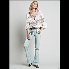 """Free People Destroyed 5 Pocket Flare Jeans NWOT 25 Free People light blue ( sahara ) Destroyed 5 Pocket Flare Jeans with stretch low rise distressed flares with blown out knee holes. Five pocket style with a double button closure and zip fly with stretch New Without Tags  *  Size: 25  *there is a black line through the tag to prevent store return   *98% Cotton  *2% Spandex  *Machine Wash Cold  *Import   Measures: 30"""" around top opening  32"""" around hips 7.5"""" rise 33"""" inseam 18"""" leg opening…"""