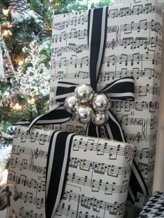 Musical gift wrap. Would be cute with jingle bells instead of ornaments.
