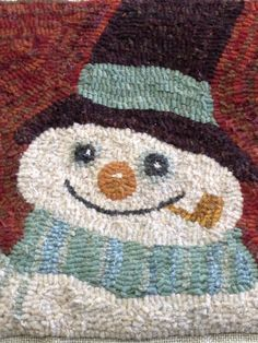 Hooked snowman. Gosh this is hooked beautifully.