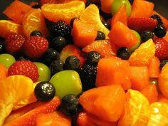 Peeled mandarin oranges, sliced papaya, raspberries, blueberries, green grapes and sliced strawberries