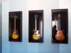 guest room doubles as music/guitar room, Part of the guitar collection.  I think there are 2-3 more.  These cases allow for display and storage, and also serve as wall art., Bedrooms Design